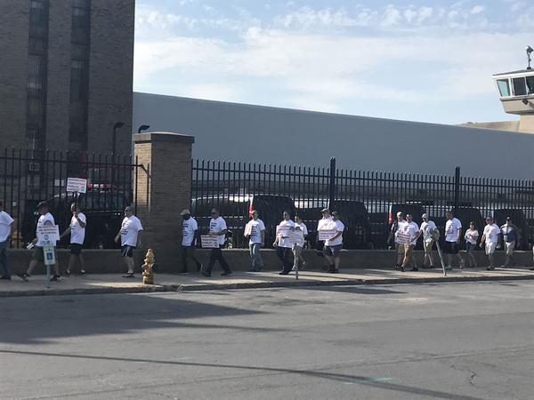 Staff from the Auburn Correctional Facility and members of a New York prison guard union picket outside of the prison to bring attention to its safety conditions.
