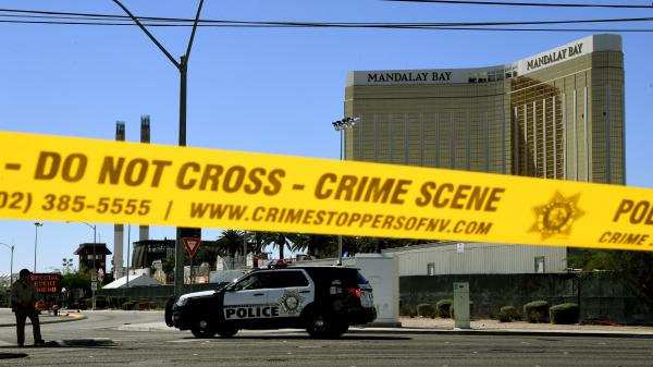 Crime scene tape surrounds the Mandalay Hotel in Las Vegas after a gunman in one of its rooms killed at least 58 people, with more than 500 others injured, when he opened fire on a country music concert late Sunday.