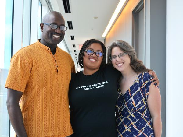 Royce and Jessica James with their daughter, Isis James-Carnes, at NPR.