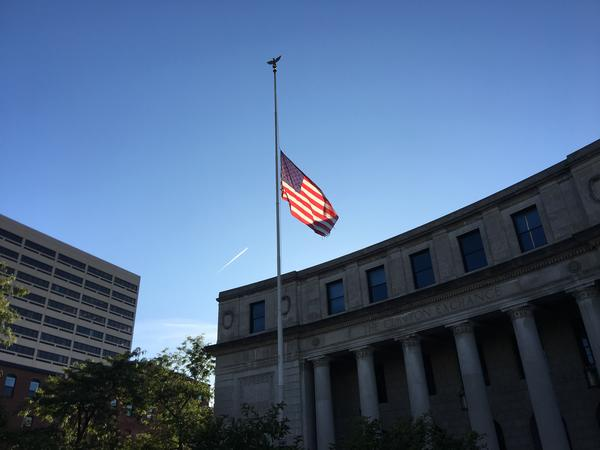 Flags flew at half-staff in downtown Syracuse on Monday.