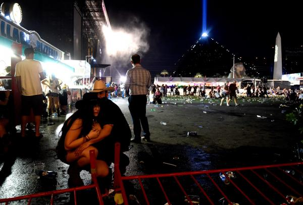 People take cover at the Route 91 Harvest country music festival after gunfire was heard on Oct. 1, 2017 in Las Vegas, Nev. (David Becker/Getty Images)
