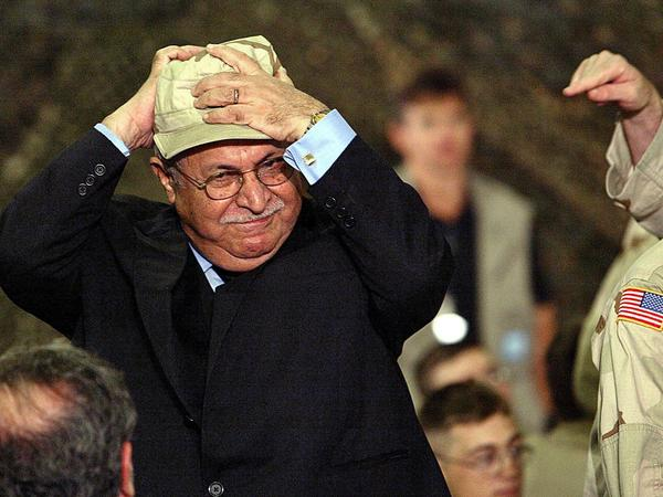 Before President George W. Bush arrived for a surprise visit to Baghdad in November 2003, Talabani put on a U.S. Army cap.