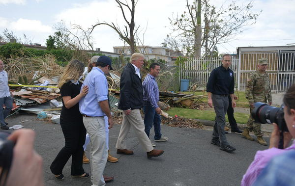 President Trump and first lady Melania Trump visit residents affected by Hurricane Maria in Guaynabo, Puerto Rico, on Tuesday.
