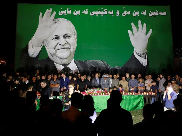 Iraqi people gather to mourn after former President Jalal Talabani's death in Irbil on Tuesday.