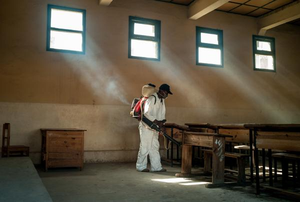 Workers spray to kill fleas in a public school in Antananarivo, Madagascar's capital. A bite from an infected flea can spread the plague, which has stricken 157 people in the island nation since August.
