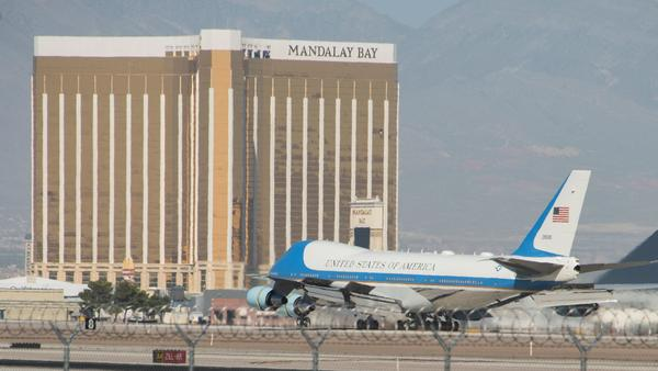 Air Force One lands at McCarran International Airport in Las Vegas on Wednesday, with the Mandalay Bay resort in the background.