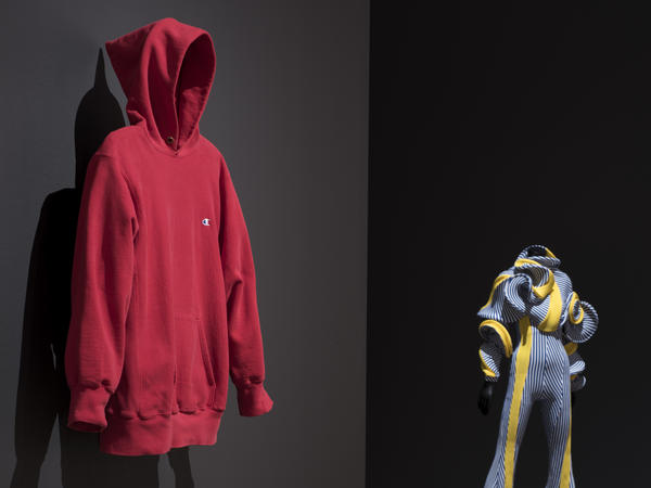 """Items: Is Fashion Modern?"" takes up the entire 6th floor of MoMA and features objects that range from futuristic to completely ordinary. Pictured here: a Champion hoodie from the 1980s and Richard Malone's <em>Jumpsuit Specimen 2017</em>."