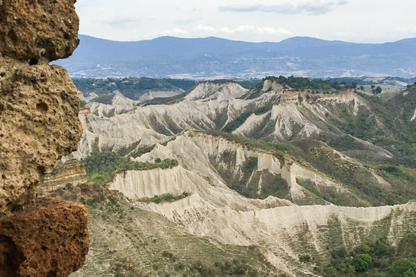 Chalk-colored canyons — called <em>calanchi </em>in Italian — create an otherworldly atmosphere around Civita.