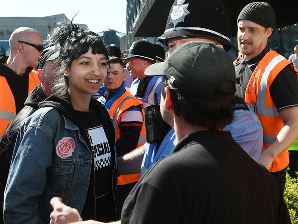 Saffiyah Khan (left) confronts English Defence League protester Ian Crossland during a demonstration in the city of Birmingham, following the Westminster terrorist attack.