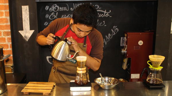 A barista at El Injerto coffee shop in Guatemala City pours water into a chemex. Guatemala has long been known for its coffee, but a culture of artisanal coffee has only recently taken root here.