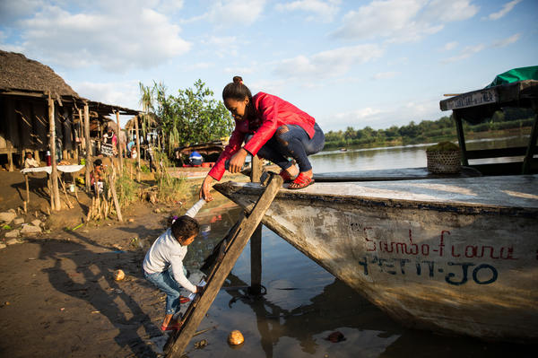 Nurse Valeria Zafisoa helps her daughter board the boat that takes staff of Marie Stopes International to villages along the Pangalanes Canal to set up clinics. They'll often travel for hours on end to reach a stop.