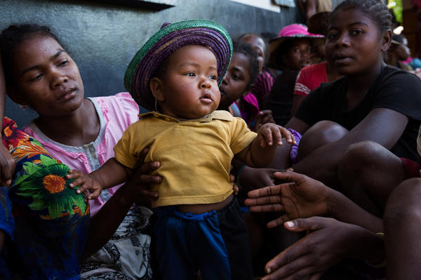 A mother and child wait outside the Marie Stopes clinic in Ambohitsara, Madagascar.