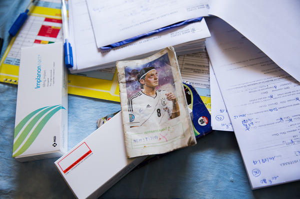 In eastern Madagascar people record their medical information in inexpensive notebooks adorned with European soccer stars. At the mobile clinic, the nurses write the women's vital signs in the ledgers and the replacement date for contraceptive implants.