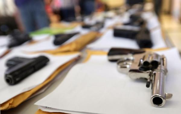 <p>In this Monday, July 7, 2014, file photo, Chicago police display some of the thousands of illegal firearms they confiscated that year in their battle against gun violence in Chicago. A new Oregon law that allows a judge to revoke the gun rights of someone authorities believe poses an extreme risk of violence. </p>