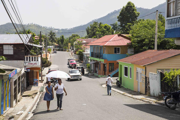 People walk down a street in Loma de Cabrera, Dominican Republic. In many ways, the Parsley Massacre remains a historical footnote in the country, seen as an uncomfortable reminder of a brutal past.