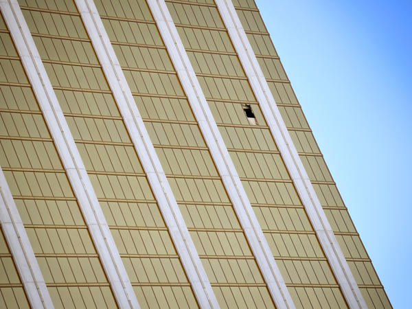 A broken window is seen at the Mandalay Bay Resort & Casino on Wednesday along the Las Vegas Strip. Investigators still don't understand why the shooter carried out his rampage.