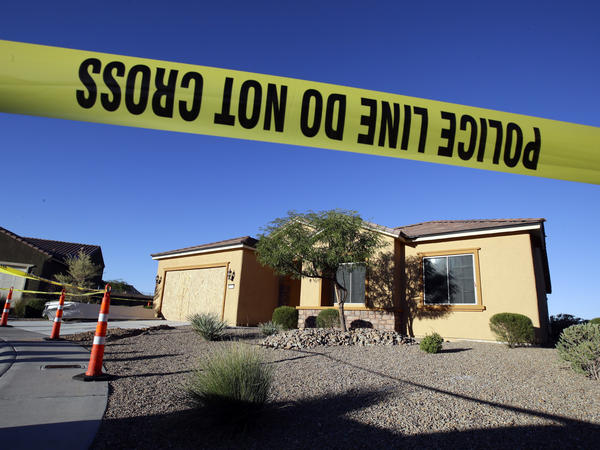 Police tape blocks off the shooter's home in Mesquite, Nev., on Monday.