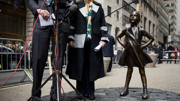 "The <em>Fearless Girl</em> statue was commissioned by State Street Corporation to raise awareness about ""gender diversity"" in corporate leadership. The company is paying $5 million after investigators concluded it underpaid female and black employees."