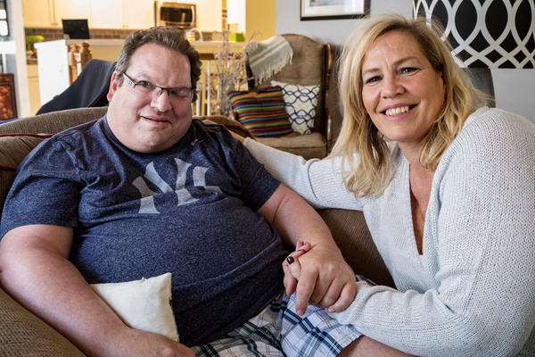 Neal Siegel, who lives with his girlfriend, Beth Wargo, is one of six disabled Iowans suing the state over its privatized Medicaid program.