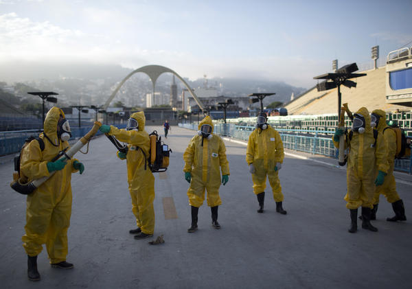 Health workers spray insecticide to combat Zika-carrying mosquitoes under the bleachers of the Sambódrome in Rio de Janeiro in January 2016.