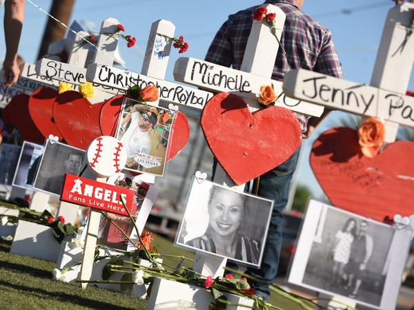 "Some of the 58 white crosses for the victims of Sunday night's mass shooting last Sunday, on the Las Vegas Strip south of the Mandalay Bay hotel on Friday. ""Their names and their stories will forever be etched into the hearts of the American people,"" Vice President Pence said while visiting the city on Saturday."