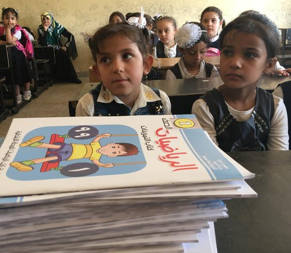 Iraqi children arrive at an elementary school in Mosul for the first regular school year in three years. Most parents pulled their children out of school when ISIS took over Mosul — and the school system — in 2014. Students this year were allowed to take makeup classes and sit for exams to make up the years they missed.