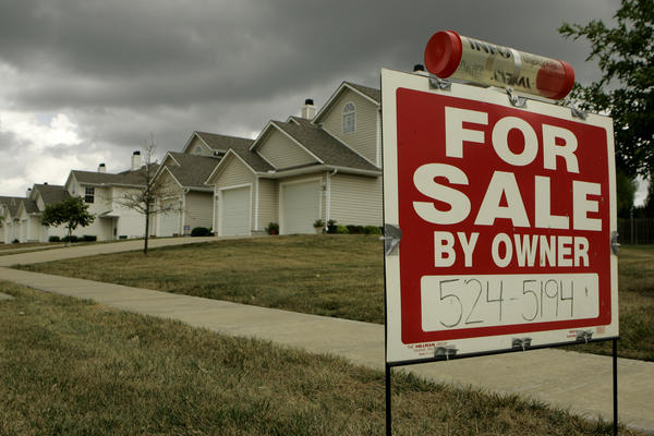 A for sale sign stands in front of a home in Lee's Summit, Mo. (Charlie Riedel/AP)