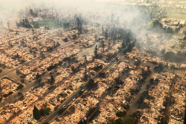 This aerial photo provided shows some of hundreds of homes destroyed in a wind-driven wildfire that swept through Santa Rosa.