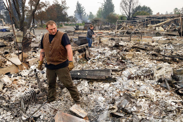 Luke Baier (left) and his wife Gina Baier look through the remains of their home in the Coffey Park area of Santa Rosa, Calif., on Tuesday.