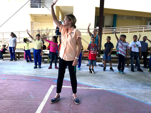 Nora Ortiz Navarro, the social worker at Escuela Gaspar Vilá Mayans, leads students in exercises to help them deal with stress and feel calm.