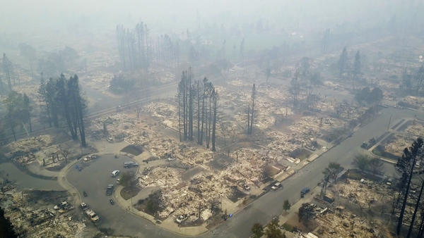 An aerial image from Tuesday shows a neighborhood that was destroyed by an intense and fast-moving wildfire in Santa Rosa, Calif., this week. Newly homeless residents of California wine country are beginning to get details about the damages.