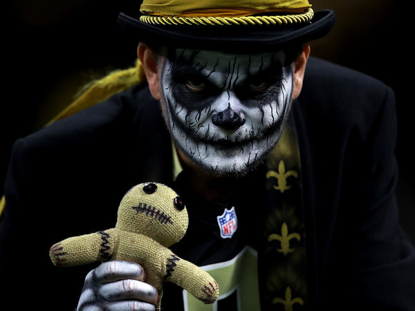 A New Orleans Saints fan holds a voodoo doll at the Mercedes-Benz Superdome in New Orleans in 2016.