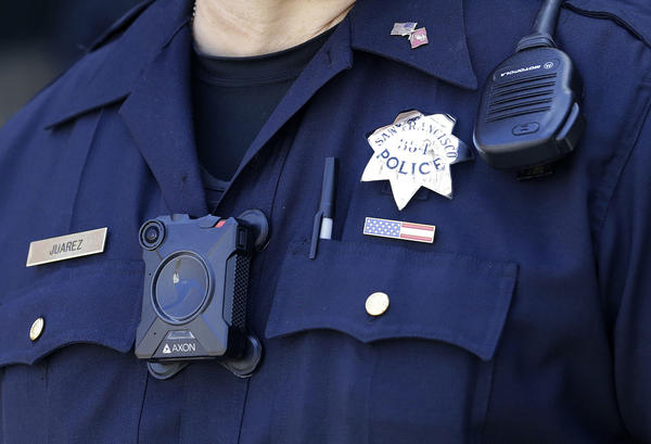 San Francisco Police officer Joe Juarez wears a body camera while patrolling outside of AT&T Park before a baseball game between the San Francisco Giants and the Cincinnati Reds in San Francisco.