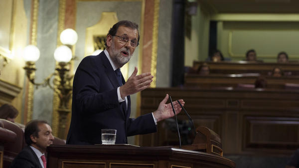 Spanish Prime Minister Mariano Rajoy speaks at the Spanish parliament in Madrid on Wednesday. Rajoy has asked Catalan leader Carles Puigdemont to confirm whether he has declared independence.