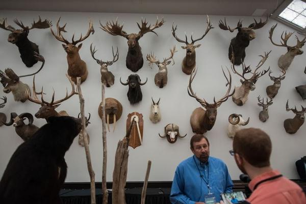 Heads and horns donated by the Boone and Crocket Club make up over 30 animal species that were once at risk of extinction. Rob Keck, WOW Chairmain (right)