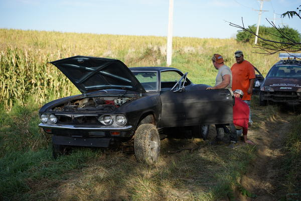 "Tom's Corvair ""high-sided"" on a dirt embankment"