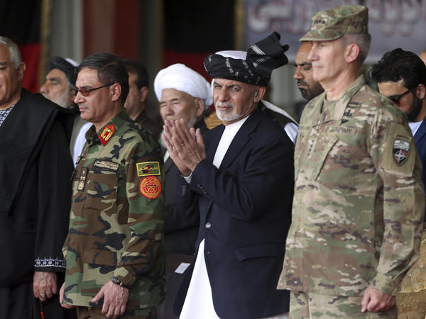 Afghan President Ashraf Ghani (second right) stands with Gen. John W. Nicholson (right) during an Oct. 7 ceremony after receiving two Black Hawk helicopters donated by the U.S. government, in Kandahar Air Field, Afghanistan.