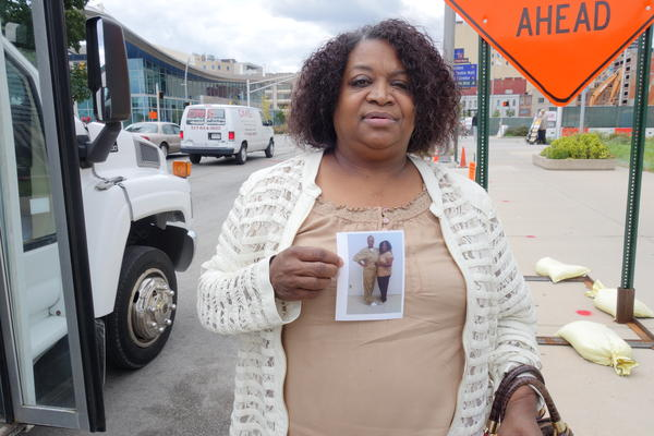 Janice McClain poses beside the Use What You've Got Prison Ministry bus, which connects people with their incarcerated family members.