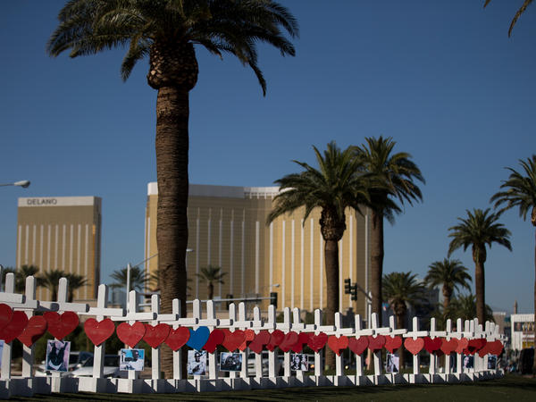 With the Mandalay Bay Resort and Casino in the background, white crosses for the victims of the Las Vegas massacre stand on the south end of the Las Vegas Strip.