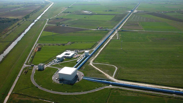 Gravitational wave observatories, like this one in Italy, use giant arms to measure tiny ripples in the fabric of space-time.