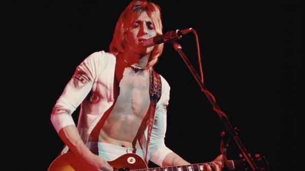 Mick Ronson onstage in 1975. Filmmaker John Brewer hopes his documentary<em> Beside Bowie </em>will earn the late guitarist a place in the rock and roll canon.