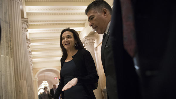 Sheryl Sandberg, chief operating officer of Facebook, walks with Rep. Tony Cardenas, D-Calif., on their way to a meeting with members of the Congressional Black Caucus, at the Capitol, on October 12, 2017, in Washington, DC.