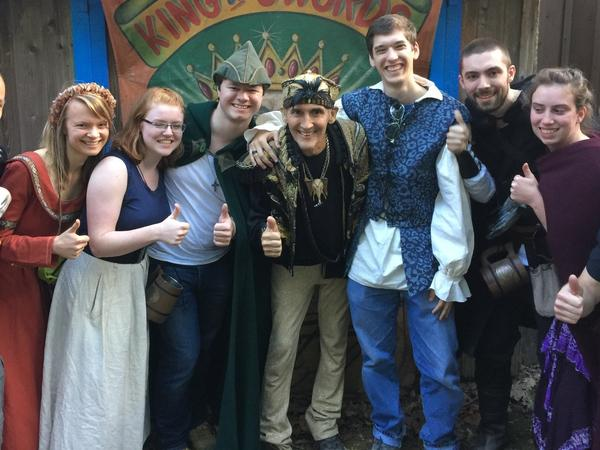 Johnny Fox, middle, gives a thumbs up with fans at the Maryland Renaissance Festival.