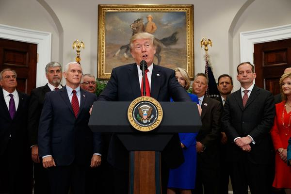 President Trump speaks before signing an executive order on health care in the Roosevelt Room of the White House on Thursday. (Evan Vucci/AP)