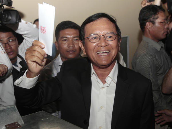 Cambodia National Rescue Party leader Kem Sokha shows his ballot before voting in local elections in Cambodia. His party made a stronger than expected showing.