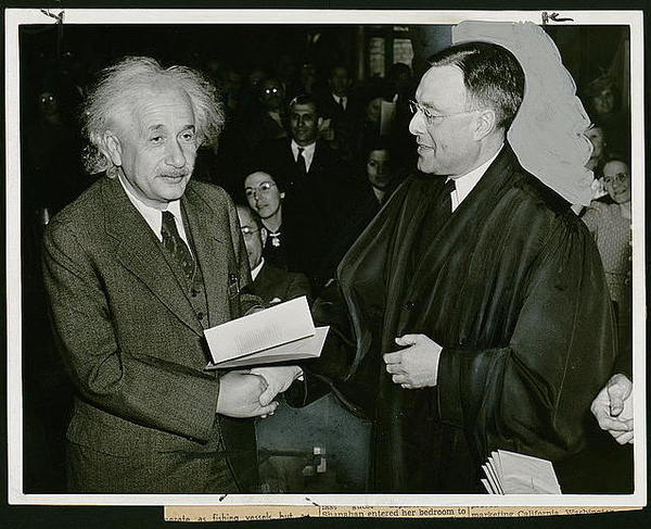 Albert Einstein receives his certificate of American citizenship from Judge Phillip Forman. A German-American, Einstein came to the United States in 1932.
