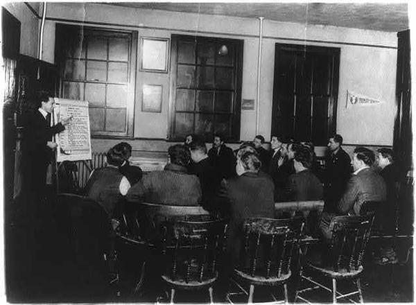 A class of Italian immigrants receives instruction in English and citizenship at a YMCA in Newark, N.J. The Department of Labor offered training services like this for newcomers to the U.S.