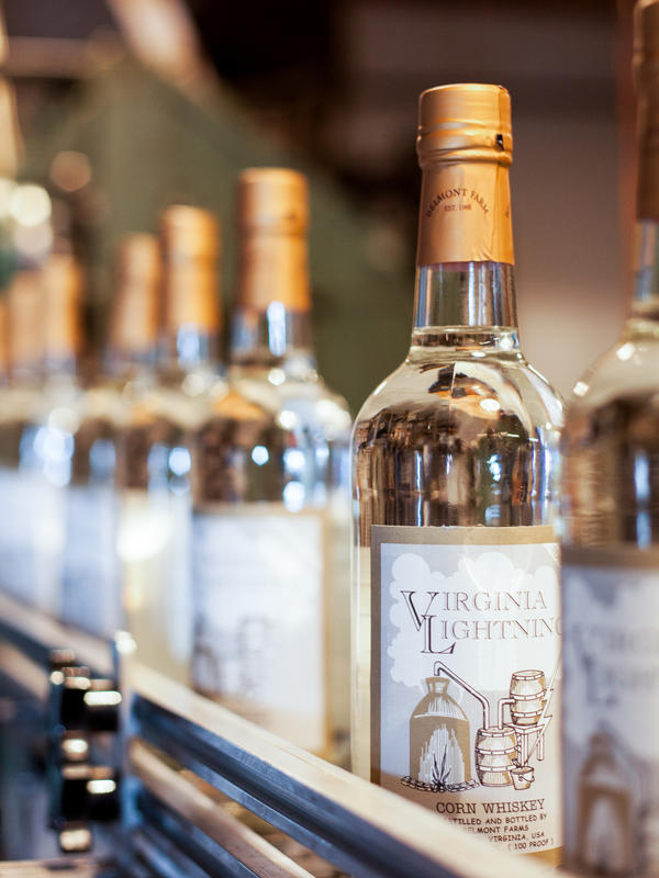 "Belmont Farm Distillery's original product, Virginia Lightning corn whiskey. ""My grandfather got involved in moonshining during Prohibition and sold his whiskey up in D.C.,"" says Chuck Miller of the Culpeper, Virginia-based distillery. ""One time they had the road blocked up there for him, and he just ran through the road block. But they shot out the back window of his car."""