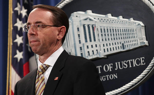 Deputy U.S. Attorney General Rod Rosenstein announces the indictment of two Chinese nationals for conspiring to distribute fentanyl in a news conference at the Justice Department on Tuesday.
