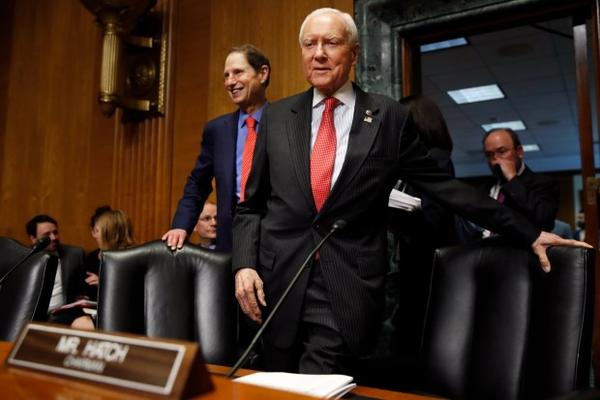 <p>Sens. Ron Wyden, D-Ore., (left) and Orrin Hatch, R-Utah, at a Senate Finance Committee hearing Thursday, Sept. 14, 2017.</p>